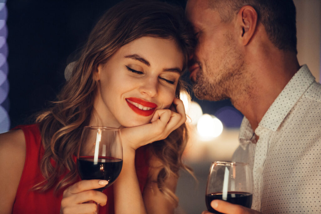 two people enjoying wine on a romantic connecticut getaway.