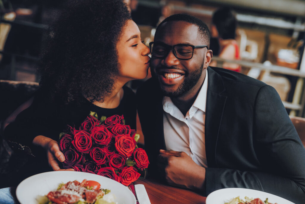 image of a smiling couple having dinner at a romantic restaurant in hartford, ct.