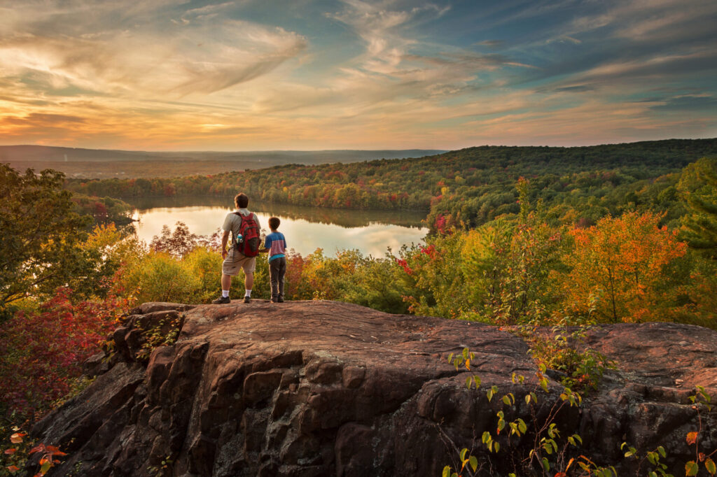 image of 2 people overlooking mountains in connecticut.