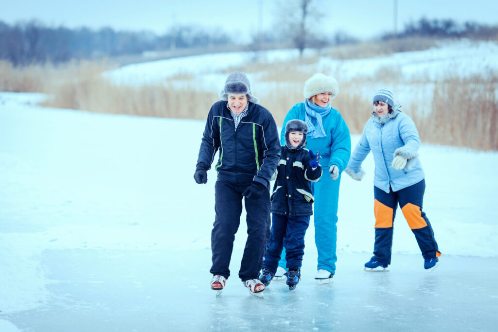 image of family outdoor ice skating in connecticut.