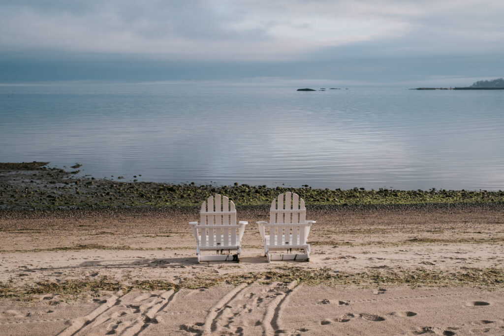 image of 2 chairs on the beach in resorts in Connecticut.