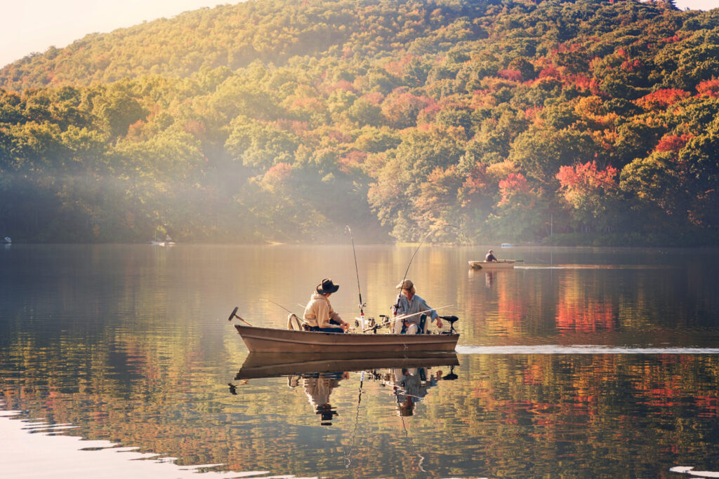 image of people on boat in lake fishing in Connecticut.