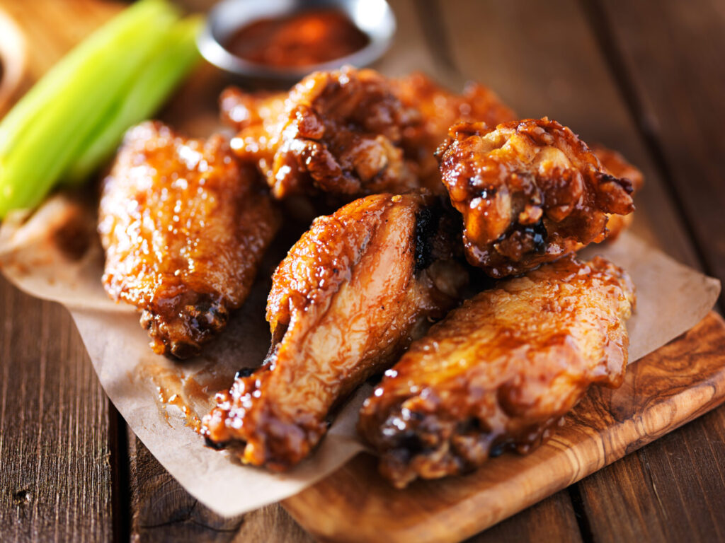 image of chicken wings on a plate with celery.